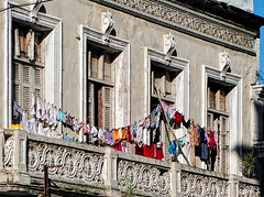 ... (Jean S..) Tags: clothes clothesline windows outdoor colors red blue balcony