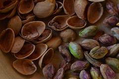The Haves And The Have-Nots (MPnormaleye) Tags: nuts shells textures pistachio food snack utata lensbaby 56mm tabletop utata:project=two
