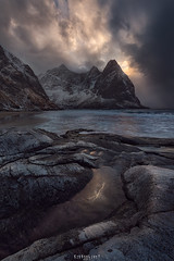 The jaws of Kvalvika (Ron Jansen - EyeSeeLight Photography) Tags: kvalvika beach lofoten norway moskenesøya fredvang hike winter snow drama jagged teeth rocks dark mood sunset sun water ocean nordland strand sand mountain mountains
