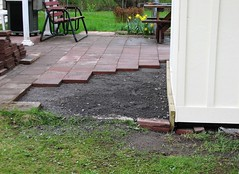 PUTTING THE PATIO BACK (richie 59) Tags: ulstercountyny ulstercounty newyorkstate newyork unitedstates trees townofesopusny townofesopus richie59 stremyny stremy outside backyard grass yard neighborhood patio home shed woodenshed 2017 workshop april2017 april222017 2010s america hudsonvalley midhudsonvalley midhudson nystate nys ny usa us constructionsite constructionarea plywoodbuilding building pavers stonedust bench dirt