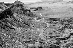 Road to Nowhere (Geraint Rowland Photography) Tags: vegas lasvegas visitnevada nevada usa unitedstatesofamerica grandcanyon grandcanyonnationalpark landscapephotography blackandwhiteamerica maverickhelicopters aerialview road travel roadtrip roadtonowhere longandwindingroad desert mountainrange canon 50mm geraintrowlandphotography art artisticphoto