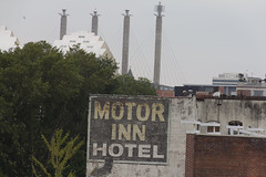 Motor Inn Hotel  Kansas City with the Kauffman Center and the Kansas City Convention Center ( Bartle Hall ) in background (A  Train) Tags: kansascity bartlehall sign ghostsign kauffmancenter skyline canon hotel crossroadsdistrict forcedperspective