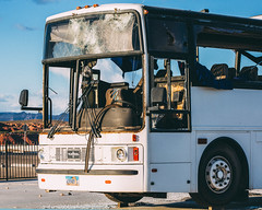 Wrecked Bus (Austin Hudson) Tags: old bus destroyed wrecked damage cracked glass curtains