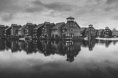 Not so colourful Netherlands (Nicolas Hoizey) Tags: europe groningen holland nederland paysbas reitdiep reitdiephaven thenetherlands bateau boat building cityscape cloud clouds eau grey harbor harbour haven house houses immeuble lake netherlands reflection sky water waterscape nl