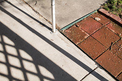 (Jeremy Whiting) Tags: geometry shadow shadows brick triangles lattice outdoors abstract composition yard sunlight orange green white gray detroit michigan royal oak jeremy whiting oakland county psychogeography intimate geography landscape new topographics sparse stark simple canon digital color