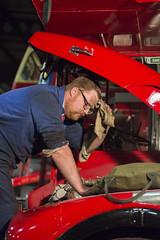 Feeling The Pressure (Matt photo3) Tags: mechanic pressure feeling red blue bus maintainence oily rag man leaning engine bonnet hood up
