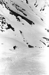 04a3871 26 (ndpa / s. lundeen, archivist) Tags: nick dewolf nickdewolf bw blackwhite photographbynickdewolf film monochrome blackandwhite april 1971 1970s 35mm austria austrian stanton stantonamarlberg tyroleanalps tyrol skitrip skiingtrip alps mountains snow snowcovered slopes skiing skislopes skiresort skiarea tirol alpine people skier cape