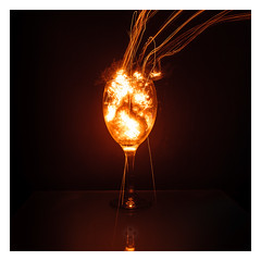 Goblet of Fire (picturedevon.co.uk) Tags: wirewool steelwool le longexposure night flame fire red orange black minimal glass reflection sparks colour wwwpicturedevoncouk photography