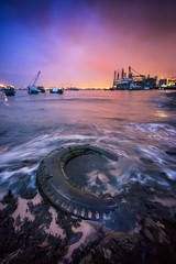 Splashing Colors (Mabmy) Tags: singapore westcoast park beach land water sea sand waves tyre rubber landscape seascape voigtlander 12mm evening sunset bluehour cloudy sony a7rii a7r2 photography mabmy