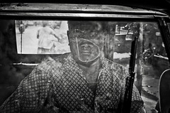 (archangelse) Tags: portrait bw man indonesia java mood pentax expression candid streetphotography documentary jakarta reflective driver k5 reportage bajaj
