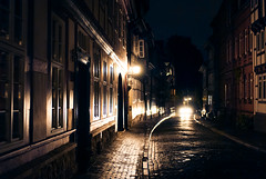 in your headlights (TIM) Tags: street light wet car rain night reflections dark nightshot stones cobblestone lamps cobbles hildesheim 30mm timberframework