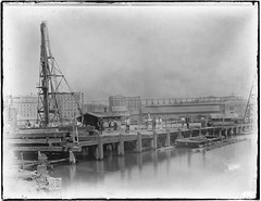 Waterfront near Pitt, Son & Badgery's Wool Stores and Gilbert's Cold Store, Pyrmont. [ The Government tug BUCRA can be identified in the middle of the image]. (State Records NSW) Tags: street york bridge for harbour north sydney southern pyrmont approach spans falsework bucra
