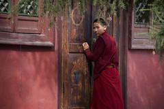 A Mongolian Monk Gives A Watchful Eye At Gandan Monastery (El-Branden Brazil) Tags: horses asian asia desert buddhist pigeons buddhism mongolia monastery monks temples camels steppes gobi nomads mongolian gandan ulaanbatar