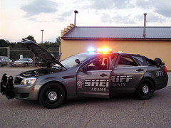 Adams County Sheriff. (dccradio) Tags: trees light tree chevrolet festival wisconsin clouds fun lights evening streetlight friendship dusk fair entertainment chevy policecar greenery sheriff countyfair telephonepole wi lightpole adamscounty patrolcar communityevent emergencyvehicle exhibitbuilding adamscountyfair adamscountysheriff