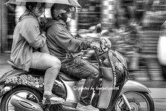 Riding in the Rain (lindaelizabeth) Tags: street bw rain umbrella canon thailand zoom scooter transportation converted chiangmai panning hdr oneimage