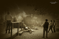 A Shoot Out (Sharon Dow Photography) Tags: uk costumes england sussex nikon westsussex britain western deadwood outfits shootout gunshot cowboysandindians southernengland southeastengland gunfire westerntown oldwesttown kingsfold d7100 nikond7100 wattlehurstfarm sharondowphotography vision:night=054 gowestern