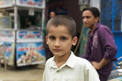 the future.. (camelot98.) Tags: street leica travel pakistan boy portrait color colour children asia child market candid streetphotography streetportrait rangefinder pakistani karachi m9 vision:people=099 vision:face=099 vision:groupshot=099