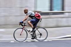 Courier at speed (jeremyhughes) Tags: london cyclist city urban courier messenger cyclecourier bikemessenger bike street speed motion movement panning bicycle riding man tattoos tattoo tattooed red messengerbag shots shorts nikon d750 nikkor 80200mmf28d fujipeloton