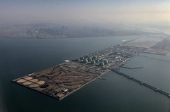 Incheon Landing (e_impact) Tags: flight aircraft terminal oil storage travel sun korea move moving flying landing approach finnair seoul hankuk windowseat a330 water sea island pipes buildings building city infrastructure