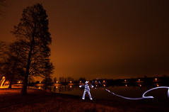 Space Hunter (pepe50) Tags: pepe50 light night lightpainting italy campogalliano cave leisure paint painting longexposure travel fun party circle fire woolsteel martian ufo alien canon canon450d emiliaromagna notte flickr lamp fiamme body lux fiatlux lake trail funny 2017 nature dark sky flare woman scintille tree water acqua blu beanch panchina