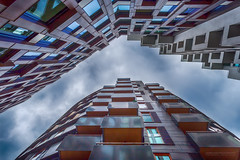 The Tjuvholmen Gap (Explored) (Normann Photography) Tags: akerbrygge oslo tjuvholmen abstractreality architecture buildings corners facade glass lines lookup mindthegap reflections shapes sky theopening windows norway no