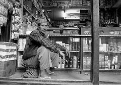 Pentax 645n Nepal HP5+ shopkeeper s (shakmati) Tags: ilford film hp5 ภาพเหมือน slr filma portra 肖像 ritratti portrét bild porträt портрет retrato portrait blanc blanco bw monochrome black white shiro negro nero street travel nepal kathmandu people world pentax 645 645n 45mm medium moyen 120