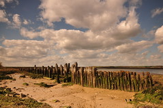 Essex South Fambridge (daveknight1946) Tags: essex river crouch landscape wood old seadefence coast sand white clouds southfambridge