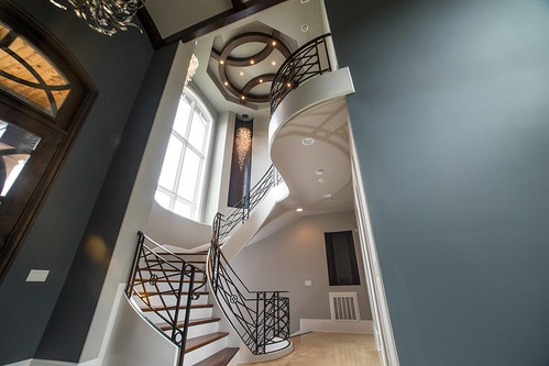 Curved staircase by Andronic's Construction in Charlotte NC