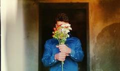 (Victoria Yarlikova) Tags: film agfa zenit122 analog lomo iso100 naturallight darkroom scan grain lightleak portrait boy flowers vintage retro 35mm smallformat pellicola