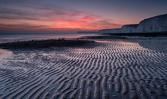 Glistening sand patterns and the white cliffs (Christopher Restall) Tags: seascape beach cliffs sunset landscape water reflection red orange yellow sand sandbeach sandybeach sandy evening birlinggap uk unitedkingdom sussex southerncoast south