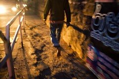 Down The Path (alisdair jones) Tags: ef35mmf14lusm man bare feet path wall street night banderawela srilanka