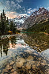 Dawn in the Canadian Rockies (PIERRE LECLERC PHOTO) Tags: mountedithcavell edithcavell mountains glaciers reflection water lake cavelllake peak summit jasper jaspernationalpark alberta canada snowcappedmountains canadianrockies rockymountains wild wilderness nature landscape adventure hiking outdoor greatoutdoors dawn sunrise morning rocks foreground calm still zen relaxing serene scenic splendor iconic spectacular wow amazing beauty naturalwonder pierreleclercphotography canon5dsr