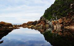 Secret Cove (DILLEmma Photography) Tags: cove water reflection africa blue cliffs mountain rocks sand horizon sky clouds stones symmetry