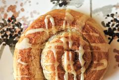 Glaze (Carrie McGann) Tags: pastry cinnamonroll orangeroll pillsbury icing glaze ceramic plate lulisanchez macromondays macro 041017 nikon interesting