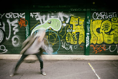 Beats (CoolMcFlash) Tags: graffiti person woman motion blur naschmarkt wall vienna austria canon eos 60d dance frau bewegung bewegungsunschärfe wien österreich wand tanzen fotografie photography street streetphotography tamron b008 18270