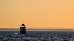 Entre tumulte et crépuscule (Danny Lamontagne) Tags: couchersoleilsunsetshadow water orange eau fleuve québec canada canon phare lighthouse