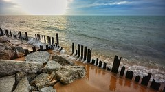 Pilings (mswan777) Tags: pilings wood rocks sand waves sunset cloud sky evening lake michigan stevensville nikon d5100 sigma 1020mm seascape landscape scenic