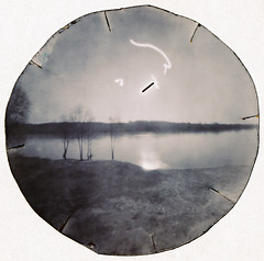 Black Sun over River, Caffenol (batuda) Tags: pinhole obscura stenope lochkamera analog analogue lid kubus juice can neodymium round circular paper solargraphy solarigraphy solargraph solarigrafia solarpath track trail arch solarisation coffee caffenol bon color colour toned landscape wide wdeangle sun sky water river tree trees ground reflection spring nature panemunė kaunas lithuania lietuva nemunas