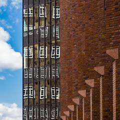 Architectural juxtaposition (Ulrich Neitzel) Tags: architecture architektur backstein brick building fenster gebäude hamburg himmel mzuiko1250mm olympusem5 reflection sky spiegelung sprinkenhof square window