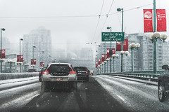Snowy drive 🚗 (Sonika Arora 604) Tags: downtown downtownvancouver vancouver vancity yvr winter cold snow car cars traffic bridge cambiestreet cambiestreetbridge nikon nikonphotography nikonphotographer city explorebc explorecanada explorevancouver dark grey shadows highlights sky fog motion movement street streetphotography canada britishcolumbia color colors naturallight light