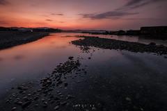 BEAT IT (jopetsy) Tags: sual pangasinan sunrise sunset seascape landscape fujifilm fuji philippines rain rock stones pebbles