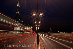 LondonBridge 033 E W (laurencemackman) Tags: lighting longexposure bridge england london tower cars glass architecture modern night reflections londonbridge concrete photography lights twilight traffic piers architect historical elevation architects shard riverthames renzopiano span streamline londonbridgestation londonskyline broadwaymalyan theshard motthayandanderson lordholford