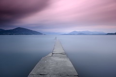 Lago Maggiore (Dariusz Wieclawski) Tags: longexposure sunset italy lake mountains water clouds zeiss lago pier nikon dusk jetty lee lombardia lagomaggiore leefilters d700 bigstopper zeissflenseszf me2youphotographylevel2 me2youphotographylevel3 me2youphotographylevel1