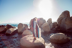 (Heather McAlpine) Tags: blue summer sun lake cold water girl canon rocks nevada tahoe laketahoe blanket lensflare sandharbor 5dmarkii