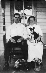 Man and woman sit with dog (Meyersdale Public Library) Tags: people men dogs women 1910s 1900s porches photobox2 mccunealbum