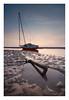 Anchored (A-D-Jones) Tags: sea orange sun seascape beach set landscape boat sand warm sailing tide low anchor mersey wallasey wirral meols