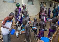 Mursi Tribe Kids Having Food In Their School, Mago Park, Omo Valley, Ethiopia (Eric Lafforgue) Tags: africa school horizontal outdoors photography education day classroom african tribal learning omovalley ethiopia tribe schoolhouse foodanddrink mursi primaryschool developingcountries settlement hornofafrica eastafrica thiopien etiopia realpeople etiopa blackskin schoolbuilding largegroupofpeople  etiopija colourimage africanethnicity ethiopi  etiopien etipia  etiyopya  africantribe mixedagerange         magopark ethiopianethnicity viilagization omo137661