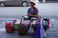 street vendor (the foreign photographer - ) Tags: road street thailand knitting bangkok silk mai vendor cloth sapan bangkhen phahoyolthin