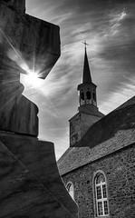 Saint-François-de-l'Île-d'Orléans (Dalliance with Light (Andy Farmer)) Tags: bw sun canada church stone cross quebec steeple sunstar îledorléans saintfrançoisdelîledorléans