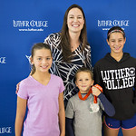 """<b>Aquatic Center Dedication of Service_100413_0232</b><br/> Photo by Zachary S. Stottler Luther College '15  Above: Christine Magnuson, two time Olympic Silver Medal winner, poses with various fans at the Luther College Service of Dedication for the new Aquatic Center.<a href=""""http://farm3.static.flickr.com/2868/10096081453_5a4b65d003_o.jpg"""" title=""""High res"""">∝</a>"""